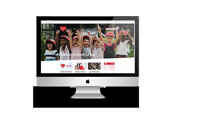 Création du site web Télévie, vue sur iMac